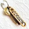 Nyckelring i trä med utskuret namn - RASMUS